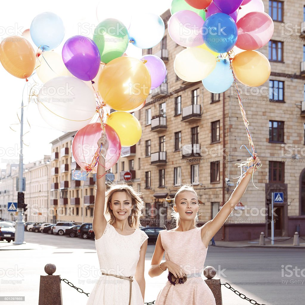 two beautiful ladys in retro outfit holding balloons stock photo