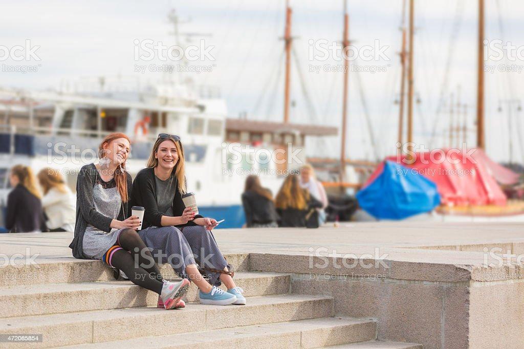 Two beautiful nordic girls enjoying life at Oslo harbour stock photo