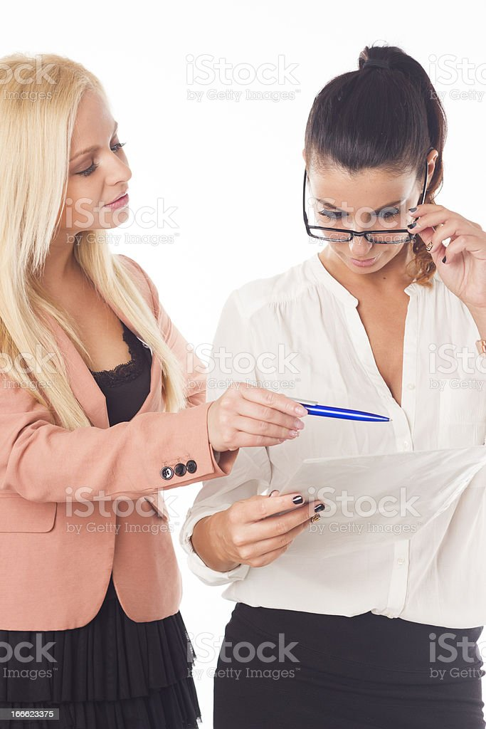 Two beautiful office workers with a documents royalty-free stock photo