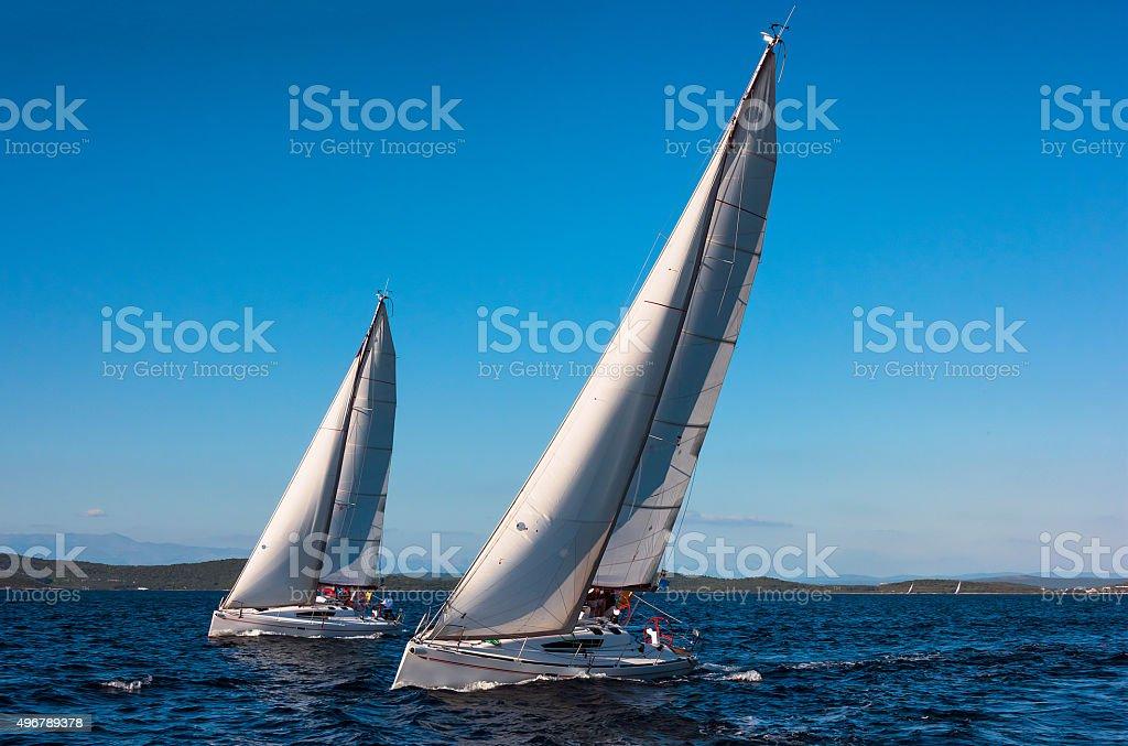 Two Beautiful Sailboats Racing  at Regatta stock photo