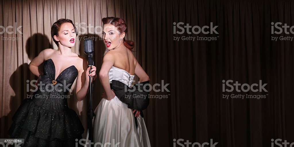 Two beautiful singers stock photo