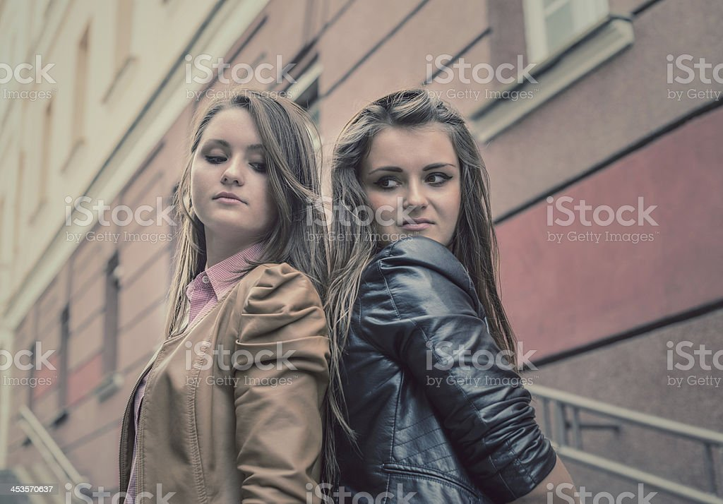 two beautiful sisters of the girlfriend stand on street royalty-free stock photo