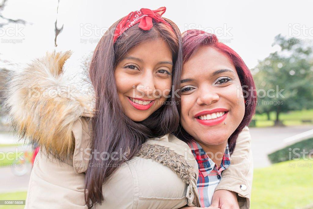 Two beautiful smiling woman friends. stock photo