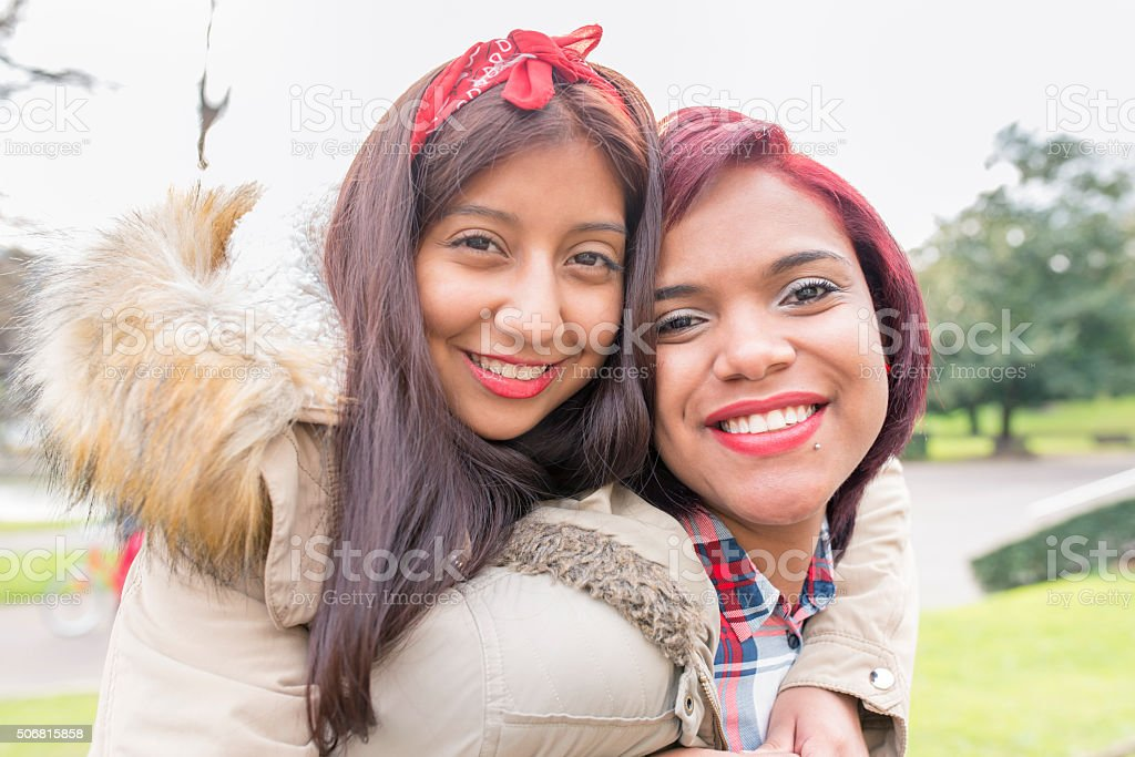 Two beautiful smiling woman friends. stock photo