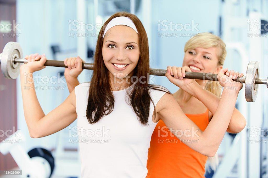 Two beautiful sportwomen make exercise royalty-free stock photo
