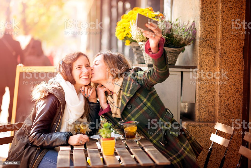Two beautiful teenagers take a break stock photo