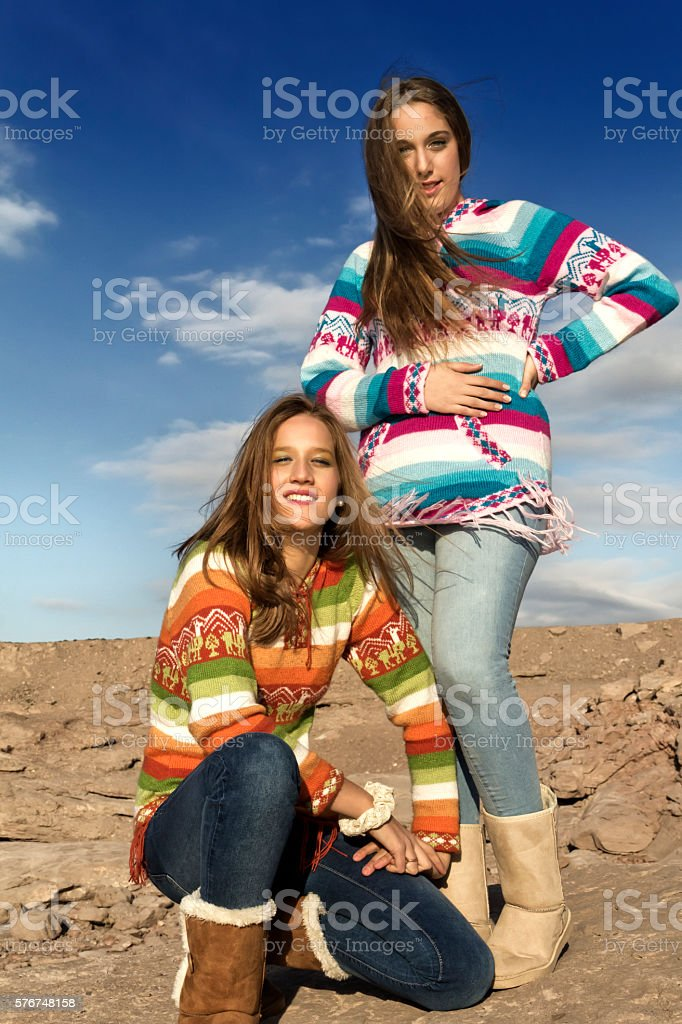 Two beautiful teens enjoy outdoor stock photo