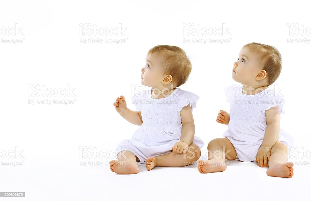 Two beautiful twins baby stock photo