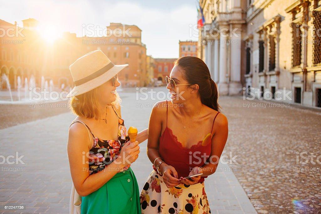 two beautiful women having fun in the city stock photo