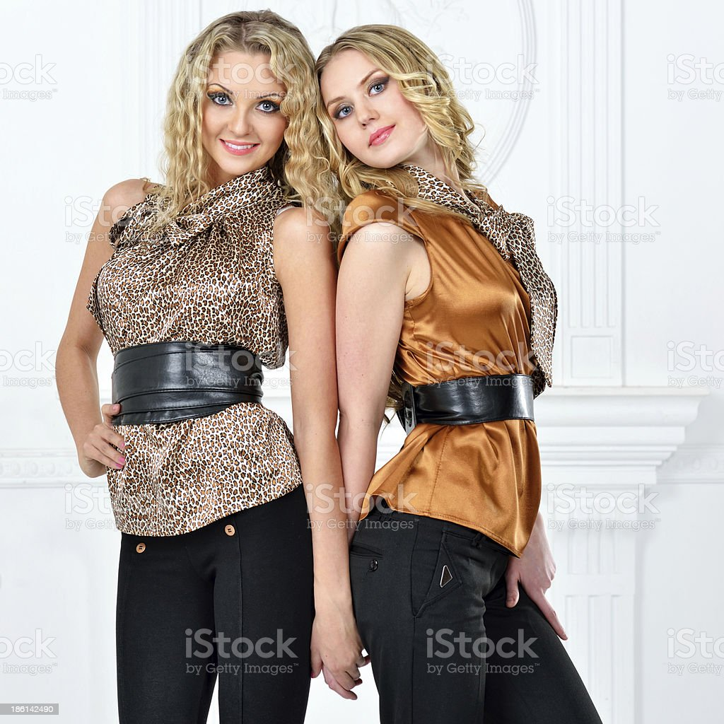Two beautiful women in elegant evening suit. royalty-free stock photo