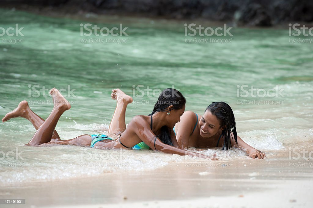 two beautiful women lays on the Exotic beach royalty-free stock photo