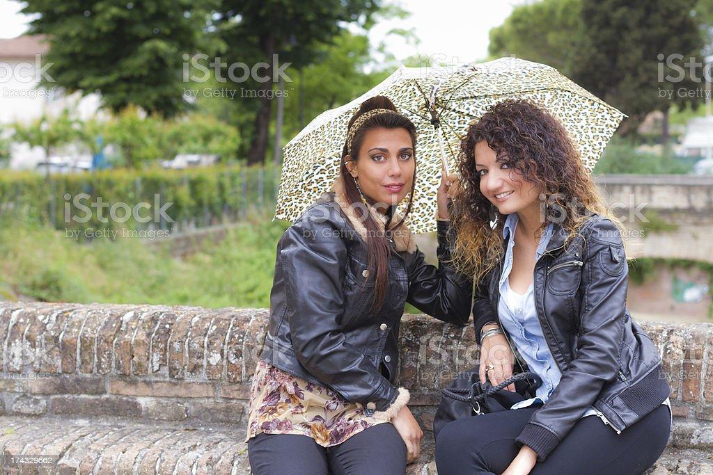 Two beautiful women smiling at camera royalty-free stock photo