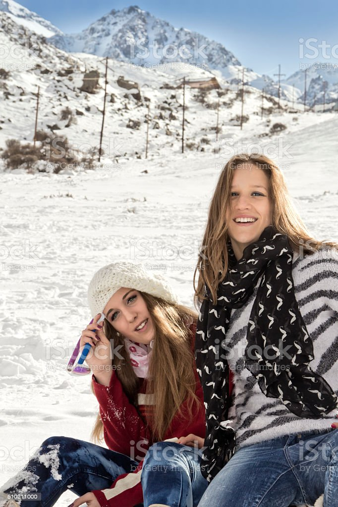 Two beautiful young in ski resort stock photo
