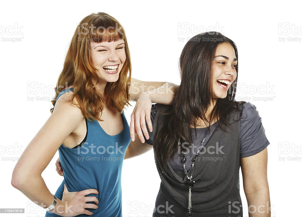 Two beautiful young women overcome by laughter royalty-free stock photo