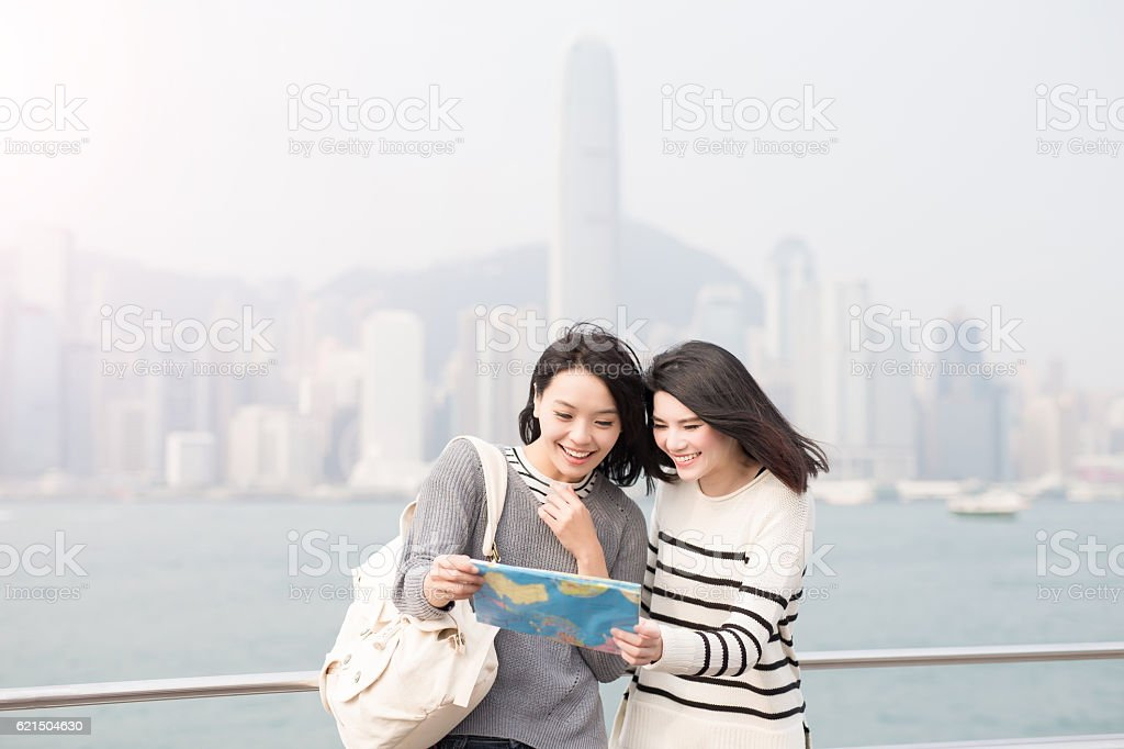 two beauty woman look map stock photo