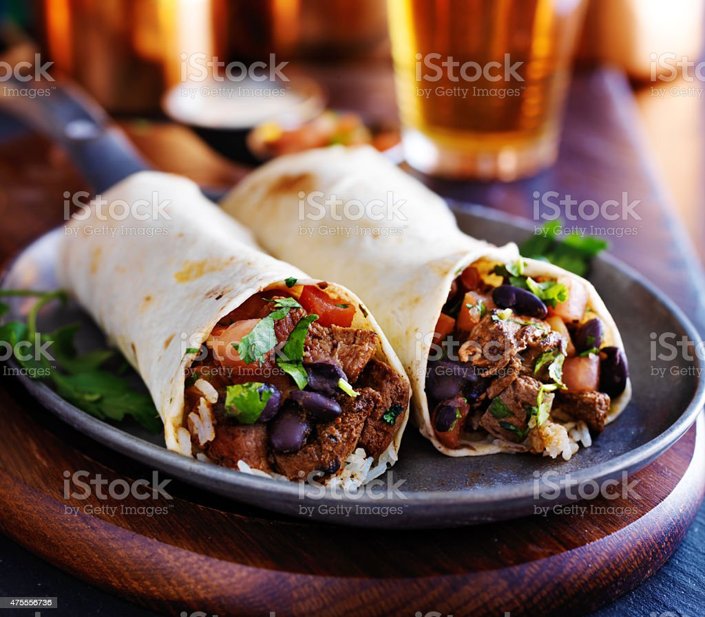 two beef steak burritos stock photo