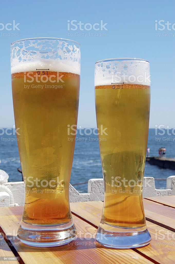 Two beer near the sea stock photo