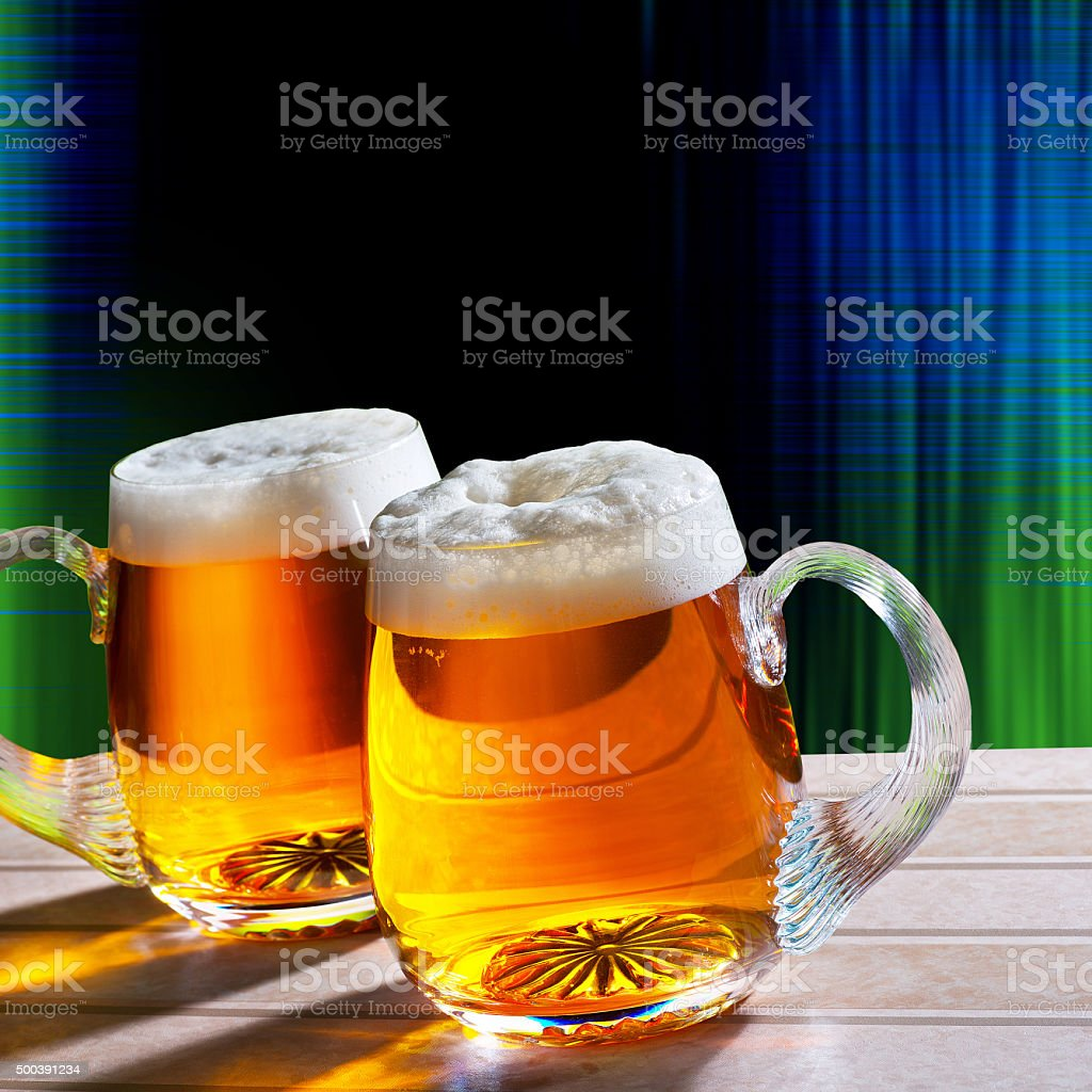 two beer on the table with modern black background stock photo