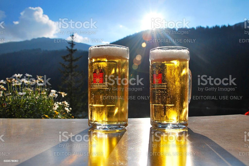 Two beers and a Swiss landscape in the alps stock photo
