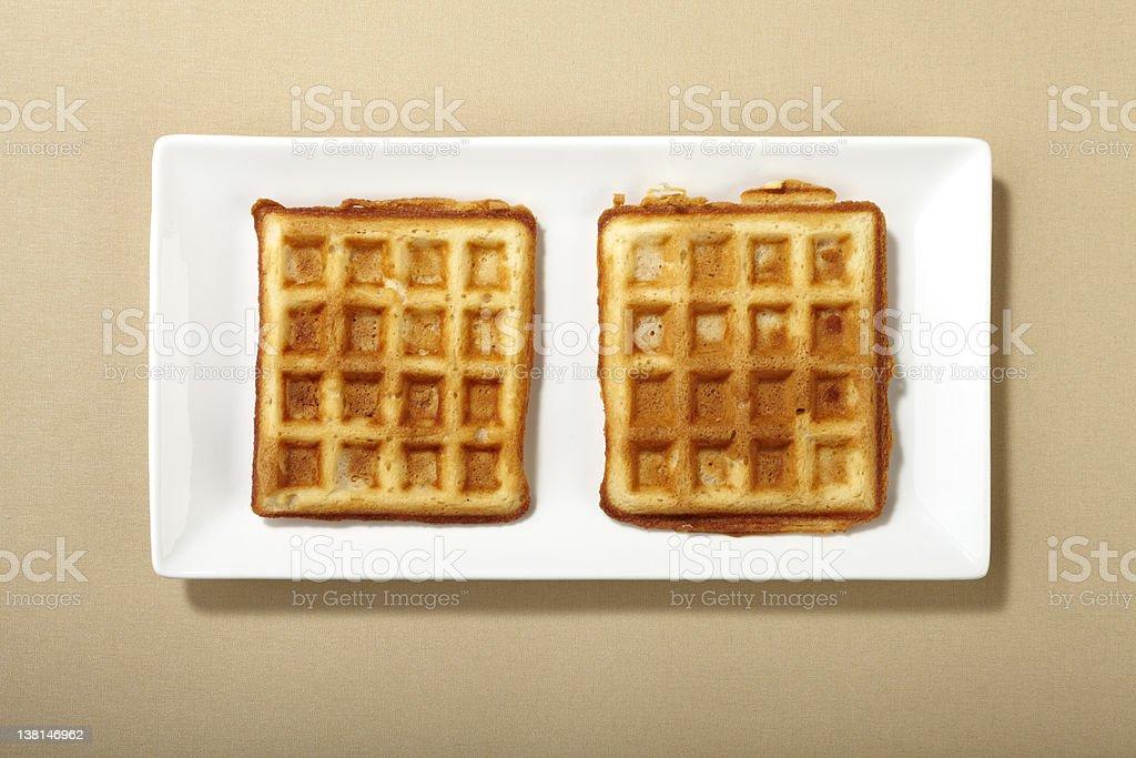 Two belgian waffle on a narrow rectangular plate stock photo