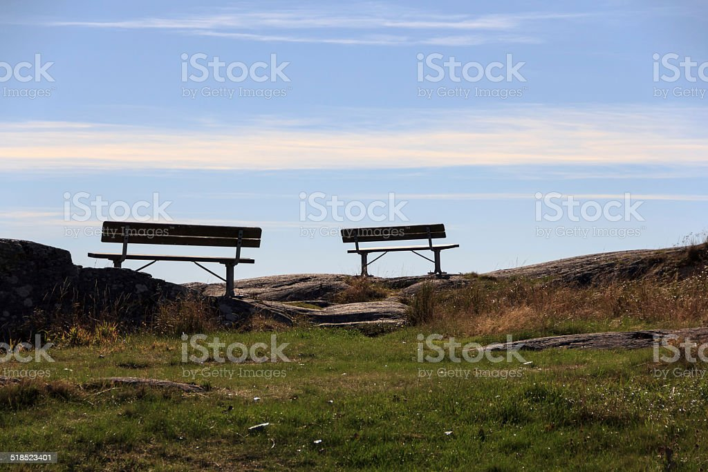 Two benches against the sky stock photo