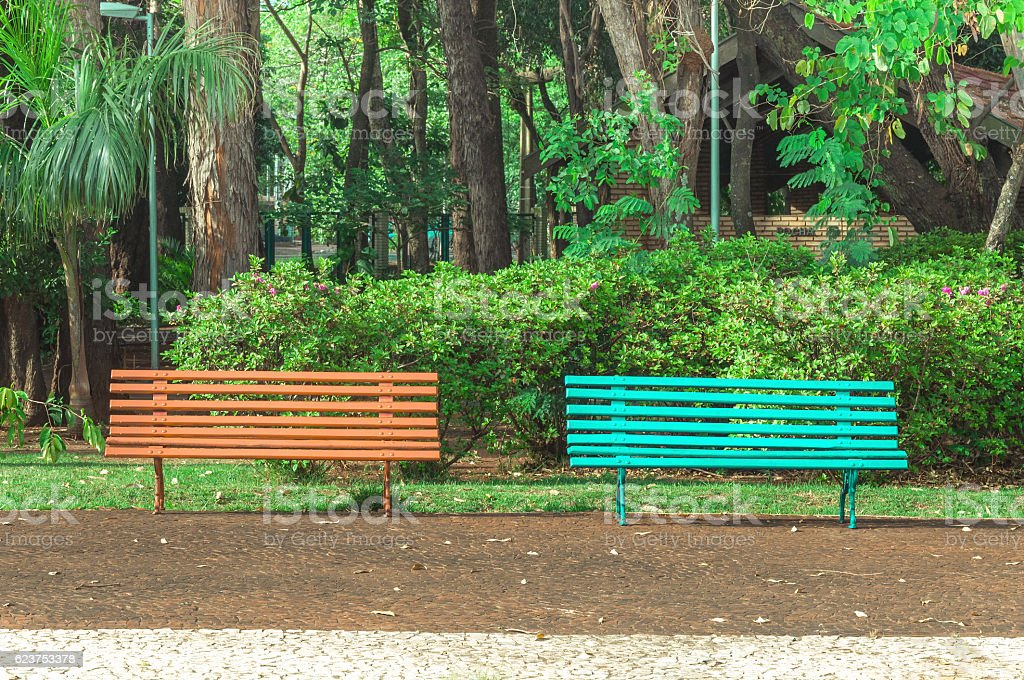 Two benches side by side on a square stock photo