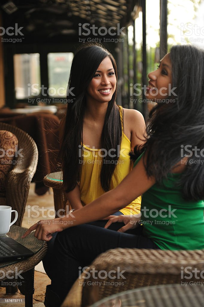 Two best friends at a pation outside stock photo