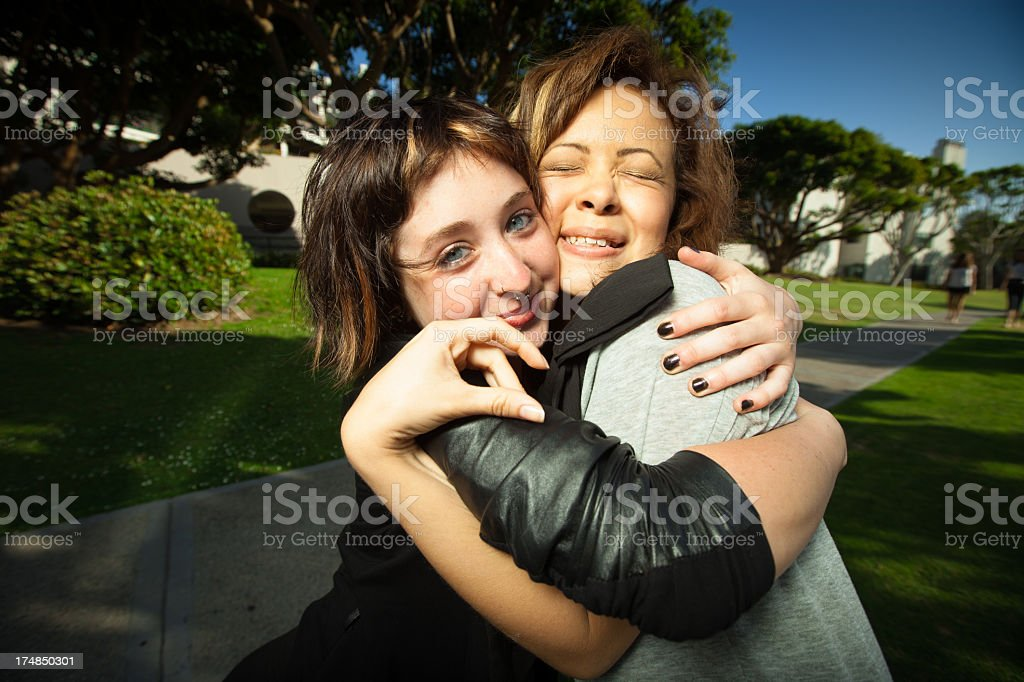Two Best Friends in a Warm Embrace royalty-free stock photo