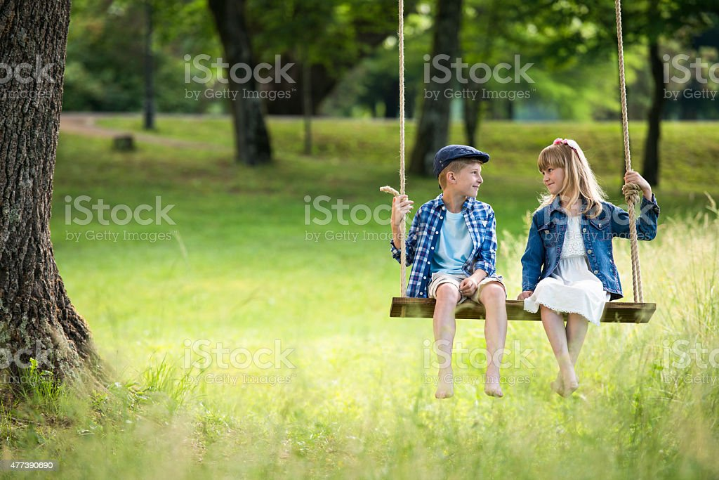 Two Best Friends On A Swing stock photo