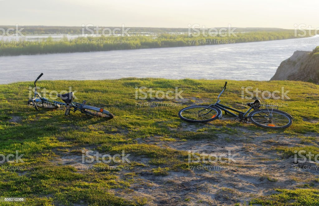Two bicycles lying on a steep bank stock photo