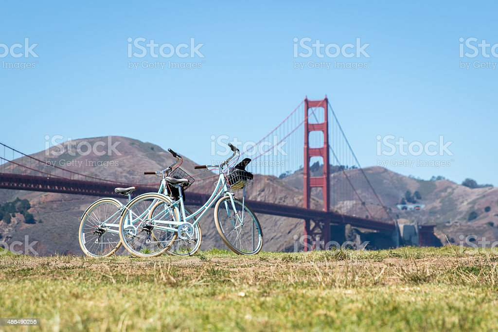 Two bicycles parked on grass near Golden Gate Bridge stock photo