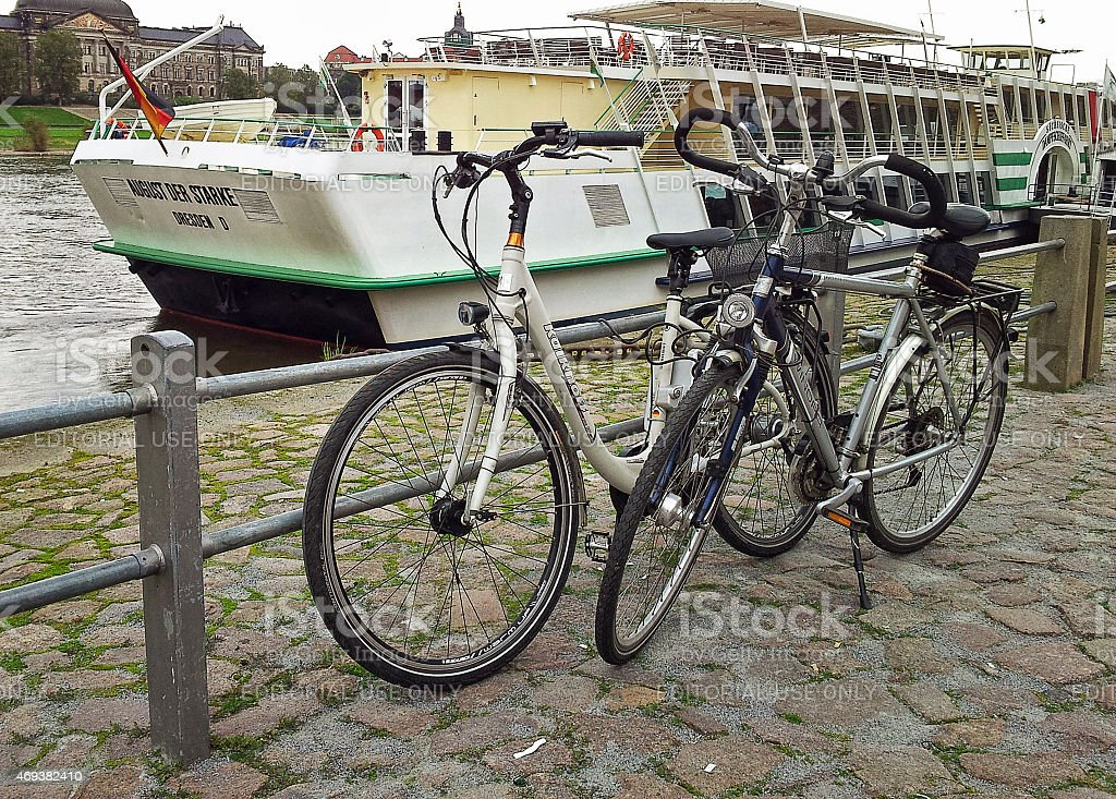 Two bicycles parked on the Dresden waterfront stock photo