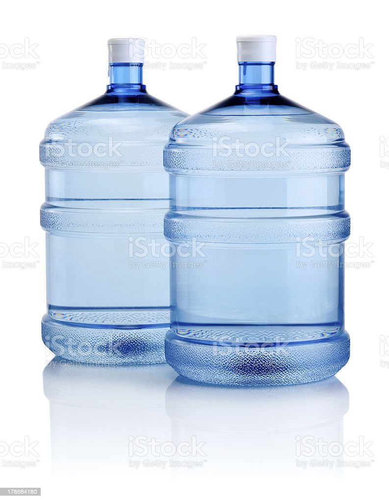 Two big bottles of water isolated on a white background stock photo
