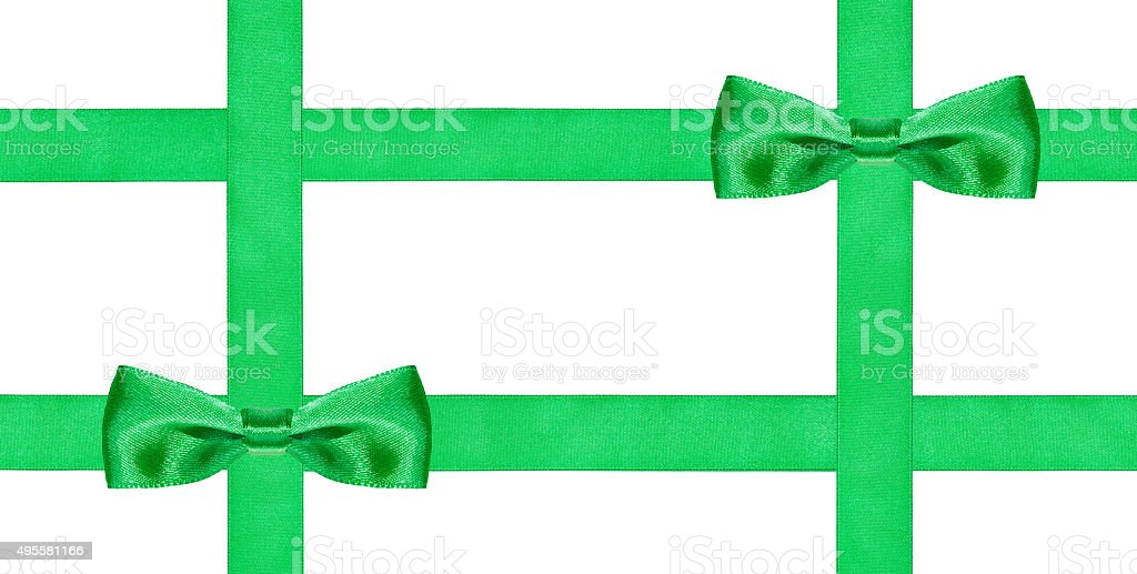 two big green bow knots on four silk ribbons stock photo