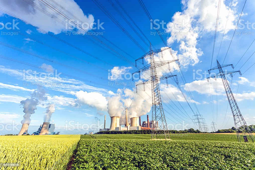 Two big power plants with electricity pylons stock photo