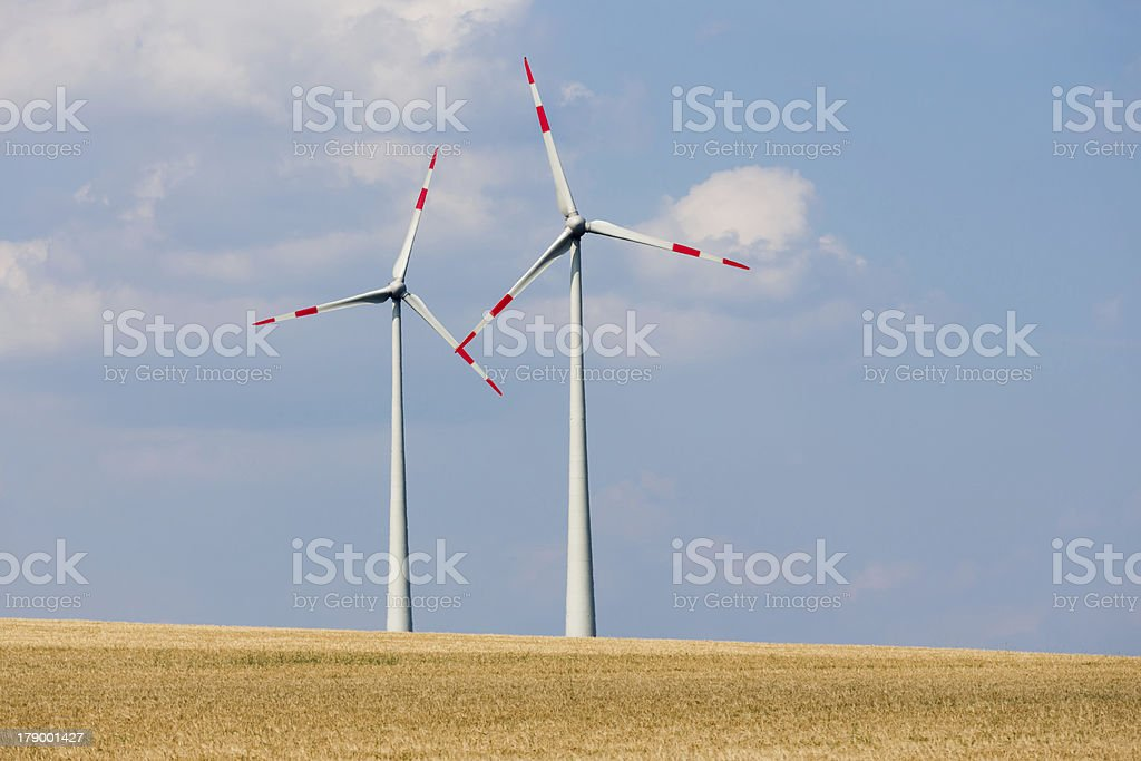 Two big wind turbines in the farmland of Germany stock photo