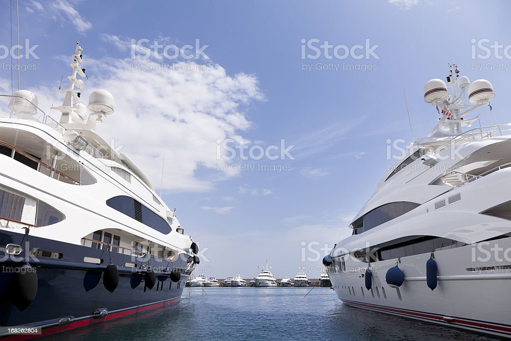 Two big yachts in the marina. Summer season. royalty-free stock photo
