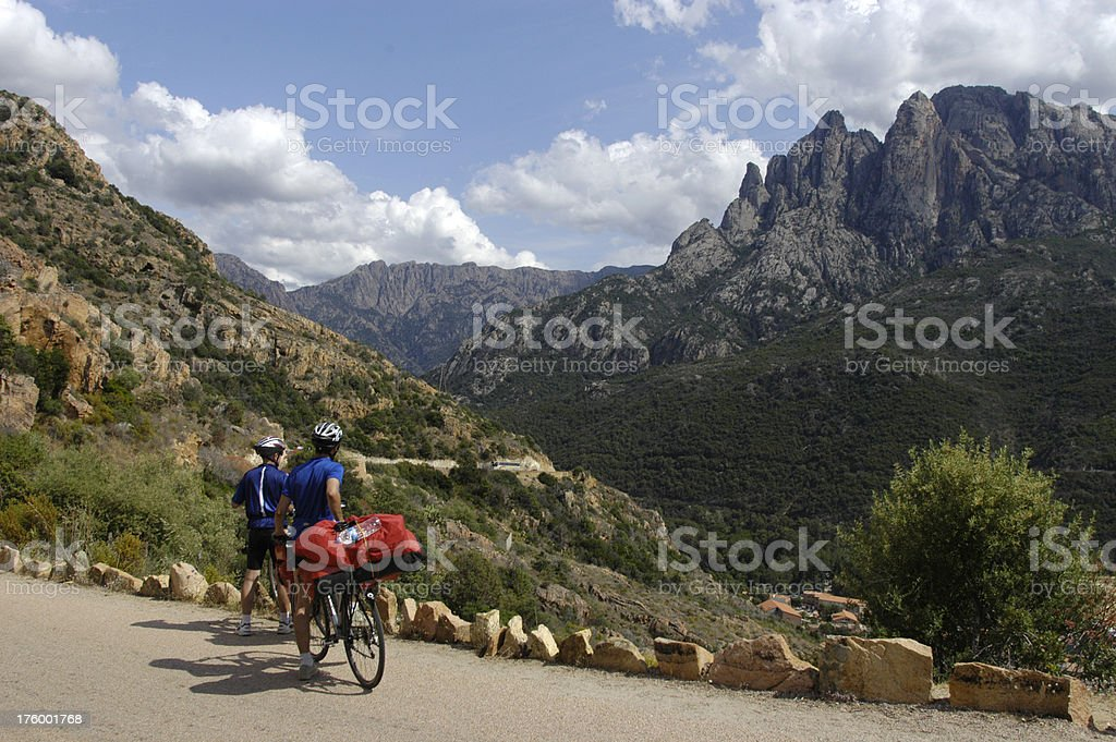 Two bikers and beautiful mountain range royalty-free stock photo