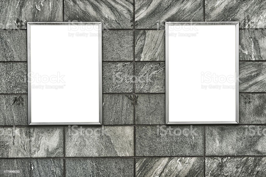 two billboards on wall in Switzerland royalty-free stock photo