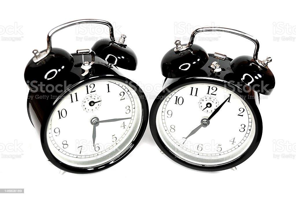 Two black alarmclocks stock photo