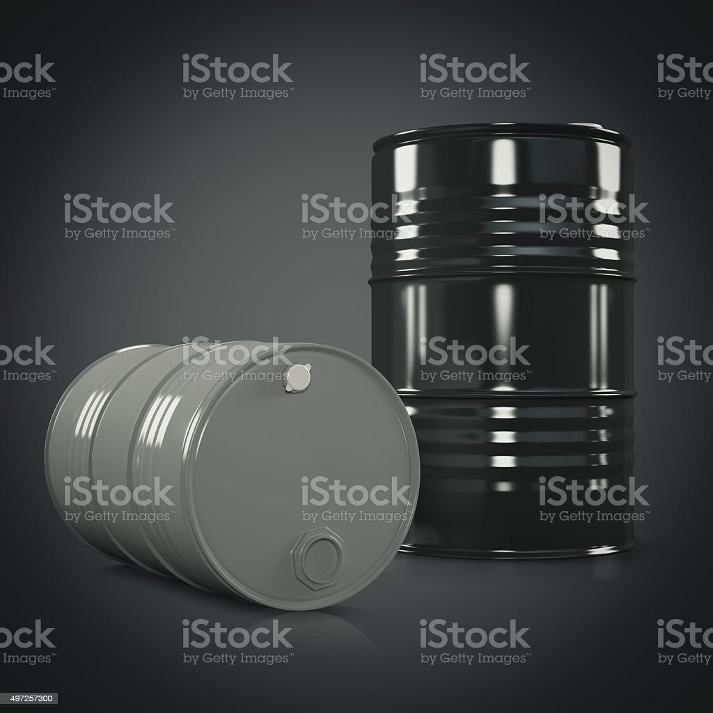 Two black and gray metal barrels on black stock photo