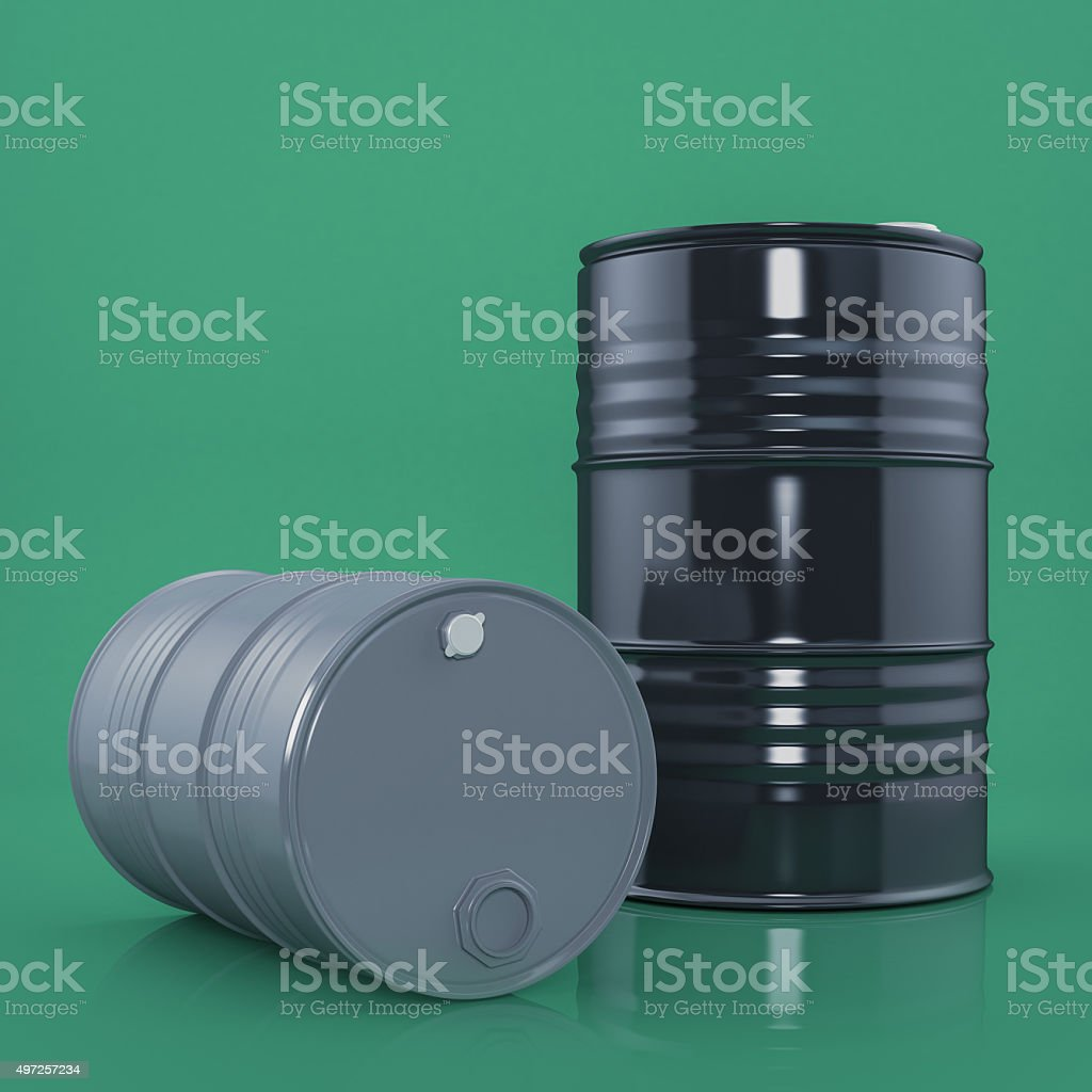 Two black and gray metal barrels on green stock photo