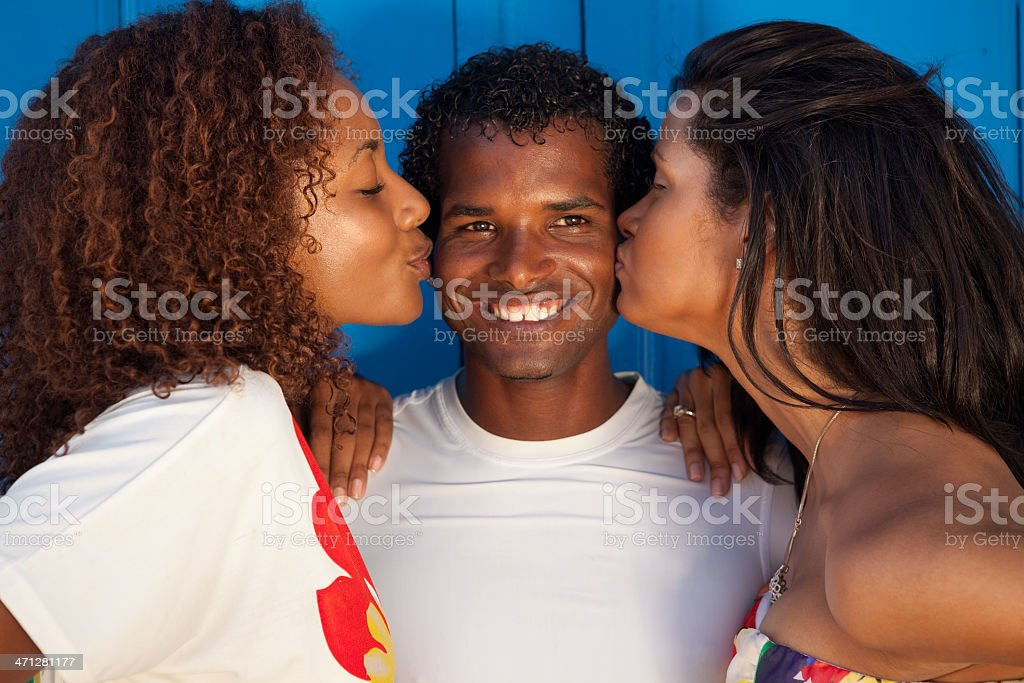 Two black dancer girls and their salsa teacher royalty-free stock photo