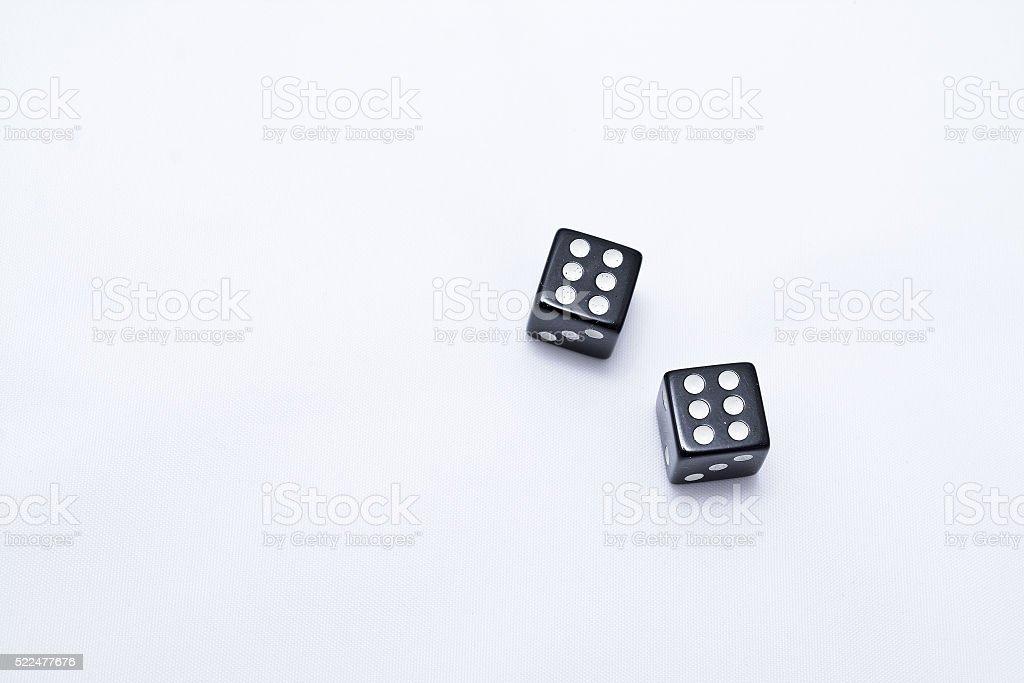 two black dice stock photo