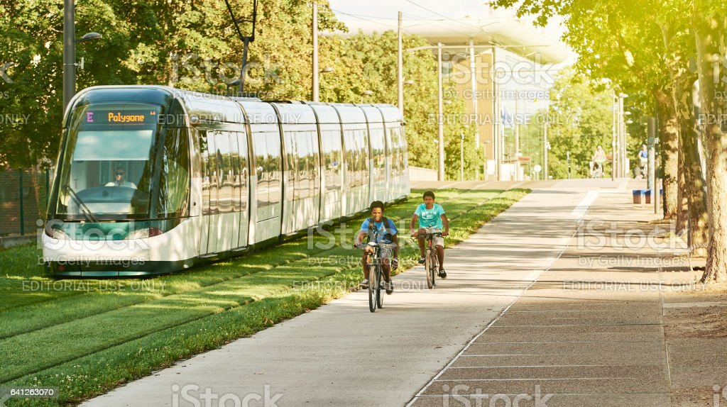 Two black ethnicity boys on heir bicycles in France stock photo