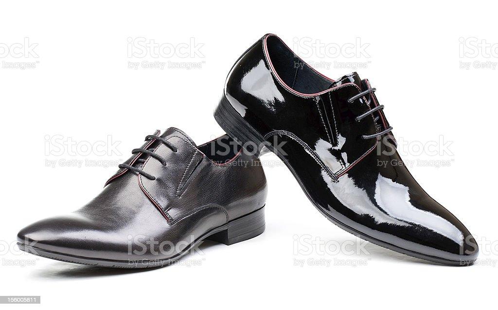 Two black men shoes against white stock photo