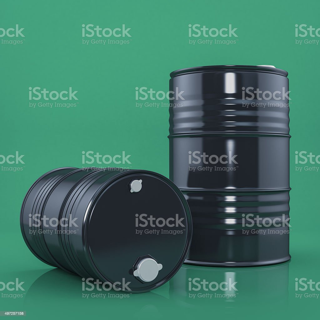 Two black metal barrels on green color background. Front view stock photo