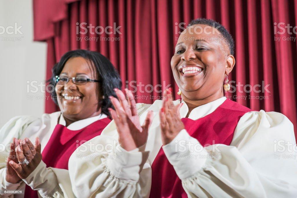 Two black women singing in church choir stock photo