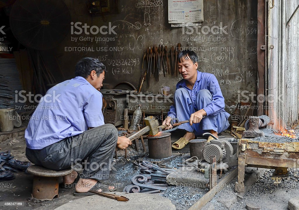 Two blacksmiths handcrafting in Hanoi royalty-free stock photo