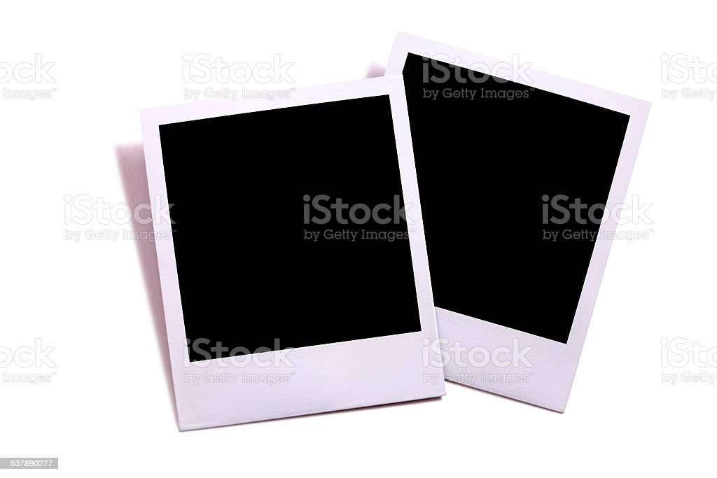 Two blank instant camera photo prints isolated on white stock photo